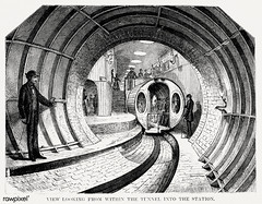 Illustration of the view when looking from within the tunnel into the station from Illustrated description of the Broadway underground railway (1872) by New York Parcel Dispatch Company. (Free Public Domain Illustrations by rawpixel) Tags: illustrationoffromillustrateddescriptionofthebroadwayundergroundrailway illustrations airflue antique broadway broadwaytunnel broadwayundergroundrailway carriage cc0 contruction creativecommons0 design drawing drawn driving experimental handdrawing handdrawn illustration illustrationoffromillustrateddescriptionofthebroadwayund interior interiorofthepneumaticpassengercar machine machinery men newpostofficeandproposedbroadwayundergroundrailway newyork newyorkparceldispatch newyorkparceldispatchcompany old operation passengercar people pneumaticpassengercar portal portalofthebroadwaytunnel precursorofundergroundpublictransitsystem process publicdomain rail railway section sketch station subway system thebeachpneumatictransit theundergroundtunnelingmachine train tunnel underground undergroundrailway undergroundtunnelingmachine vintage