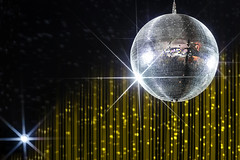 Disco ball with stars in nightclub with striped yellow and black walls lit by spotlight, party and nightlife entertainment industry (IrisPhotoStudio) Tags: ball circle sphere disco party star mirror dance music nightclub clubbing nightlife night number striped yellow black wedding event holiday fun festive celebration birthday new year christmas lights dj reflection shine bright abstract modern spotlight decoration club entertainment pop glass glitter sparkle effect equipment spot laser leisure rotate evening russianfederation