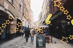 London (Wintermarchen) (goodfella2459) Tags: nikonf4 afnikkor24mmf28dlens konowintermarchen200 35mm c41 film analog colour london city streets pedestrians buildings signs manilovefilm