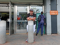 MaldenLeanandWait (fotosqrrl) Tags: malden massachusetts streetphotography urban mbta t station maldencenter bollard entrance