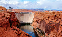 Glen Canyon Dam and Bridge in Page, Arizona (lhboudreau) Tags: glencanyondam bridge dam glencanyon page arizona pagearizona river coloradoriver plateau gorge canyons lakepowell lake lakes canyon outdoor landscape rock sky cloud clouds rocky redrock powerline tower towers cliff cliffs water powell hydroelectric power generation hightensionwire rustcoloredsand