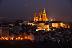 Prague Castle and St. Vitus Cathedral at night - 2 of 3 (Pavel's Snapshots) Tags: prague praha czech czechrepublic castle palace church temple cathedral illumination illuminated night winter old historic historical ancient medieval heritage town urban city europe european bright haze houses roofs nikon nikkor 85mm d750 dark orange fallingstar gothic towers street lights lighting tripod travel tourism famous landmark place destination popular sky hill metropolitan