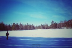 Winter (Mister Blur) Tags: frozen lake lac raymond mount tremblant quebec canada winter snow invierno lhiver walking alone man blue sky freezing 18c celsius snapseed dusted dido nikon d7100 35mm nikkor f80 rubén rodrigo fotografía