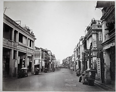 Hotz collection: Hong Kong, Queen's Road Central, ca. 1870 (Charles in Shanghai) Tags: charles shanghai albert hotz albertus paulus hermanus holland china trading company handelscompagnie rotterdam universiteit leiden university bibliotheek bijzondere collecties special collections early photography libslibs librariesandlibrarians hchc haagsche courant nrc delphernl perzië john thomson london mattie boom rijksmuseum everyoneaphotographer exhibition gwulo bw blackandwhite monochrome people chinese portrait hong kong hongkong queens road central sedan chair shop sign