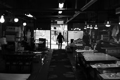 Day's catch (Elios.k) Tags: indoors people oneperson man center shopper visitor fish japanese fishmarket morningmarket mutsuminato mutsuminatoekimaeasaichi food stall shop store market silhouette contrast walkingout storefront street streetphotography light lights emptystalls wideangle blackandwhite bw monochrome travel travelling december2017 vacation canon 5dmkii photography hachinohe aomoriprefecture tōhokuregion tohoku honsu asia japan