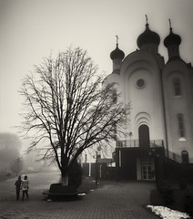 children and church in the fog (Pomo photos) Tags: church architecture tree people pair child children kids trees road house religion building mist misty dark darkness evening dull dusk dim fog sky brown noir urban street catherdral window temple autumn winter xa3 fujifilmxa3 fujifilm sepia blackandwhite bw monochrome mono mood blackwhite