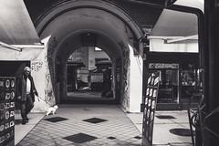 beware of the dog.. (Harry Pammer (temporarily off)) Tags: vienna wien aust austria österreich naschmarkt night people nacht menschen bw bnw sw schwarzweiss blackwhite blackandwhite street strase streetphotograhie tunnel hund dog
