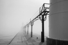 Hidden Lighthouse (mswan777) Tags: pier lighthouse mist fog weather outdoor structure architecture building scenic monochrome ansel black white apple iphone iphoneography mobile st joseph michigan shadow