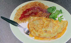 Cheesy_vm (Guyser1) Tags: food potatoes eggs cheeseomelette canonpowershots95 westyellowstone pointandshoot