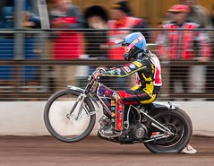 Wheelie panned (kimbenson45) Tags: leicester scottnicholls action bike black blue colorful colors colourful colours competition competitor fence helmet motion motorbike motorcycle motorsport movement outdoors pan panning race racing red rider spectators speedway sport track wheelie white winner yellow