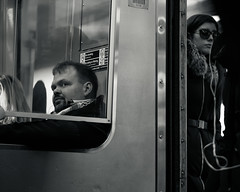 Commuting (kristenscotti) Tags: olympus chicago chicagoland usa blackandwhite bw black white streetphotography street spring winter bokeh capturestreets visuals microfourthirds portrait outside art city people monochrome penf mono exterior day interior subway l train commute woman man couple shadows reflections highcontrast absoluteblackandwhite transportation beauty glasses wall glass window reflection shadow fun life second scarf citylife two pieces split abstract door sliding metal shiny urban persons raw streetphotographer fashion downtown fauxfur windycity us illinois lights