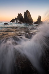 The Edge of the Hump (Christopher Smith Creative) Tags: rock blue beach seastack goldenhour newsouthwales camelrock sunset waterexplosion water coast rockpool coastal
