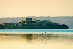 Capodimonte, Bolsena Lake, Central Italy (Claudio_R_1973) Tags: lake landscape bolsenalake centralitaly lazio italy tuscia countryside reflex reflections capodimonte peninsula village town sunset warm orange stillness outdoor autumn fall calm birds