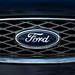 Close-up of FORD sign on a car