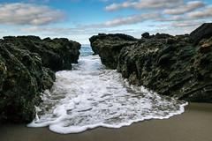 In a Tight Spot (tquist24) Tags: california lagunabeach nikon nikond5300 outdoor pacificocean victoriabeach beach clouds coast foam foamy geotagged ocean outside rock rocks sand shore sky water