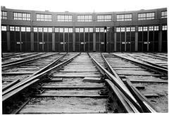 Arrivals (batuda) Tags: 35mm film bw om2n om 2835 ilford pan400 fridge d76 stock landscape city town railway depot garage šančiai kaunas spring april 2016