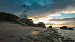 (Laszlo Papinot) Tags: lighthouse sand sunrise cloud water pointlonsdale bay morning rock