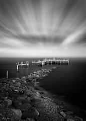 Rocky Point Remnants (mikeyatswb) Tags: warwick rhodeisland unitedstatesofamerica us rockypoint amusementpark pier jetty rocky shore cloudstreaks longexposure infrared 830nm singhray iray