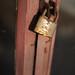 Rusty old padlock on a door