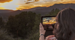 Sunset Savior (Wes Iversen) Tags: arizona clichesaturday hcs nikkor24120mm sedona hands mountains photographers sunsets tablet technology trees woman