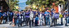 2018 - Mexico - Oaxaca - Wedding Party Parade - 2 of 3 (Ted's photos - Returns late Feb) Tags: 2018 cropped mexico nikon nikond750 nikonfx oaxaca tedmcgrath tedsphotos tedsphotosmexico vignetting camera photographer calledemanuelgarcia oaxacacalledemanuelgarcia calledemanuelgarciaoaxaca streetscene street marchingbandmusiciansdrumstubahornsentertainersdenimdenim jeanssun glassesglassesshadowshadowsdrummerdrummer boydrummingherchherch drumcanoncanon cameramarchingmarchers streetparty people peopleandpaths pathsandpeople bollards ballcap umbrella wideangle widescreen