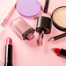 Women's cosmetics on pink background