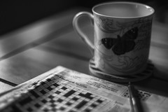 time to put your feet up (Redheadwondering) Tags: 118picturesin2018 71crosswordpuzzleday 71 crossword blackwhite bw stilllife table sonyα7ii sonyf1450mmlens