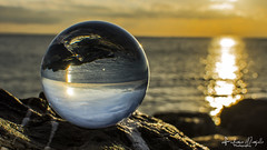 Sunrise (Federico Margallo) Tags: nikon nikond7200 nikkor nikkor35mm sunrise sea ball reflections yellow blu glass glassball