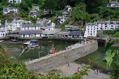 3KB06171a_C (Kernowfile) Tags: cornwall cornish pentax polperro water mud boat reflections rocks trees bushes hills slope houses cottages pier cornishharbours