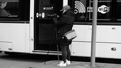 Framing Her Shot (byronv2) Tags: blackandwhite blackwhite bw monochrome edinburgh edimbourg scotland saintandrewssquare photographer camera tram street candid peoplewatching tripod newtown