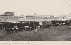 Wool Waggons in Eagle Street, Longreach, Qld - 1911 (Aussie~mobs) Tags: vintage queensland australia longreach 1911 shops stores streetscape woolbales waggons ellisandellis saddlers eaglestreet jwatson oystersaloon forrest auctioneer