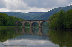 old bridge over the Meuse by Anchamps (El Greco Travelphotography) Tags: belgium travel spring pentax pentaxk50 landscape view nature water river reflection bridge mountains trees wallonië