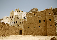 View Of A Traditional Adobe House, Hadramaut, Yemen (Eric Lafforgue) Tags: arabia arabiafelix arabianpeninsula architectural architecture blue bluesky building colourpicture day facade hadhramaut hadhramawt hadhramout hadramaout hadramawt historical history horizontal housing lowangleview nopeople placeofinterest sun sunshine traditionalarchitecture whitecolour yemen yemeni 0094yemenlafforgue