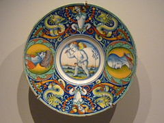 Glazed earthenware maiolica (also called majolica) plate with a winged putto on a hobby horse (Angie Naron) Tags: art plate italianmajolica glazedearthenware italian gettymuseum