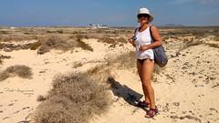 Alone in the desert (piotr_szymanek) Tags: fuerteventura outdoor marzka woman milf portrait face eyesoncamera beach hat glasses sunglasses landscape 1k 20f 5k 10k