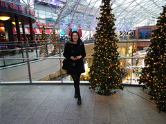 Nina at Victoria Square Shopping Centre, Belfast December 2018 (sean and nina) Tags: victoria square shopping centre belfast north northern ireland uk united kingdom eire irish shops stairs platform viewing people place candid public indoor inside winter december 2018 christmas nina pose posed posing black coat fur hood dm doc marten boots trees beauty beautiful gorgeous stunning charm charming woman female girl lady girlfriend fiancee wife happy married serb smile smiling