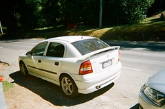 2004 Holden Astra rear (Matthew Paul Argall) Tags: kodakflashsingleusecamera fixedfocus 35mmfilm 800isofilm kodak800 disposablecamera singleusecamera car vehicle automobile transportation holden holdenastra generalmotors badgeengineering