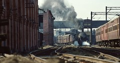 Delhi Junction India  |  1994 (keithwilde152) Tags: ir wp pacific wp7604 delhi junction india 1994 station city buildings architecture carriages tracks passenger train steam locomotives outdoor winter sun