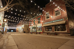 Quaint little town (GLC 392) Tags: quaint little lil town down lights christmas building buildings store fronts tree trees ally holly mi michigan pure quiet sunday night