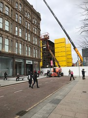 View along Donegall Place towards Royal Avenue (John D McDonald) Tags: iphone iphone7plus appleiphone appleiphone7plus belfast northernireland ni ulster geotagged bankbuildings andersonmcauley andersonandmcauley amc yellow containers yellowcontainers shippingcontainers