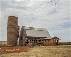 Disintegrating Three (A Anderson Photography, over 3.3 million views) Tags: barn silo hay canon redearth tire fence