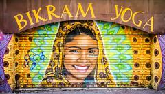 Bikram Yoga (TablinumCarlson) Tags: europa europe frankreich france marseille sud südfrankreich bouchesdurhône provencealpescôte d'azur provence côte golfe du lion mittelmeers méditerranée mediterranean mittelmeer leica m summicron composition woman street photography art mural grafitti yoga bikram laden shop rolltor tor gate 28mm portrait rollo indien india