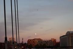 Full moon opposite the sunset (danielhast) Tags: columbus ohio moon fullmoon sky clouds airplane building bridge ohiostateuniversity