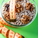 Healthy breakfast oatmeal with nuts and measuring tape thumbnail