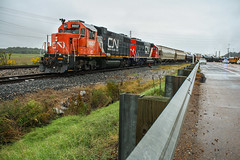 Blocking Traffic (weshendrix) Tags: cn canadian national yazoo city mississippi ms train railfan railfanning railroad railroading rails freight manifest local emd ic illinois central standard cab diesel engine locomotive gp382 vehicle outdoor road grass sky highway