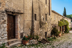 Farfa, Central Italy (Claudio_R_1973) Tags: village rural antique old wall architecture door window building urban outdoor farfa sabina centralitaly reatino italia italy lazio street color road