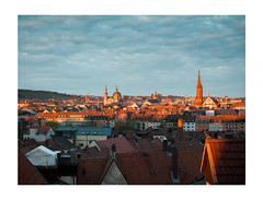 In the Set of the Sun (Thomas Listl) Tags: thomaslistl color 50mm würzburg sunlight warm light shade shadows sunset dusk sky blue orange city urban cityscape churches houses town clouds ngc dove
