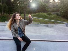 Girl Pointing Upwards towards a Light at a Skate Park while Sitting (Jonatan Svensson Glad (Josve05a)) Tags: cute child happy smiling people smile caucasian happiness looking childhood kid women person human pretty cheerful fun joy outdoors youth play playful playing outdoor children activity kids playground younggirl 14years