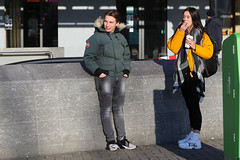 Stationsplein - Amsterdam (Netherlands) (Meteorry) Tags: europe nederland netherlands holland paysbas noordholland amsterdam amsterdampeople candid streetscene people center centrum centre stationsplein centraalstation boy homme guy male teen twink girl femme smoking fumeur fumer smoker sneakers baskets trainers skets nike fila nikeairmax270 airmax270 jeans bomberjack cold froid dutch january 2019 meteorry