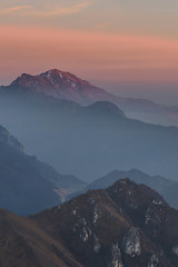Peaks at dusk III (Mattia Ferraboli) Tags: manualfocus nature naturallight availablelight italy sony sony7rii sonyalpha7rii sonyilce7rm2 sonyalpha 7rmii 7rm2 7rii ilce7rm2 ilce canon canon702004 ef70200mmf4l 70200mm 70200mmf4l canonef70200mmf4l peak peaks 2019 february dusk sunset pink blue yellow orange mountain mountains iseo lakeiseo trentapassi cornatrentapassi brescia sky cloud clouds mist misty haze hazy fog foggy grass evening shadows highlights landscape trekking backpack walk f4 f16 gradient